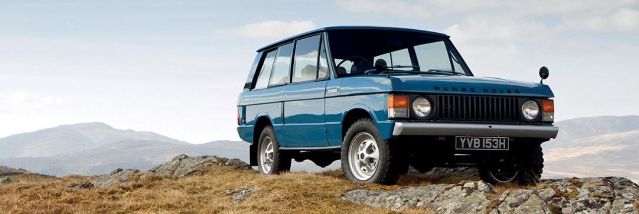 Range Rover Original in blue on top of a rocky hill